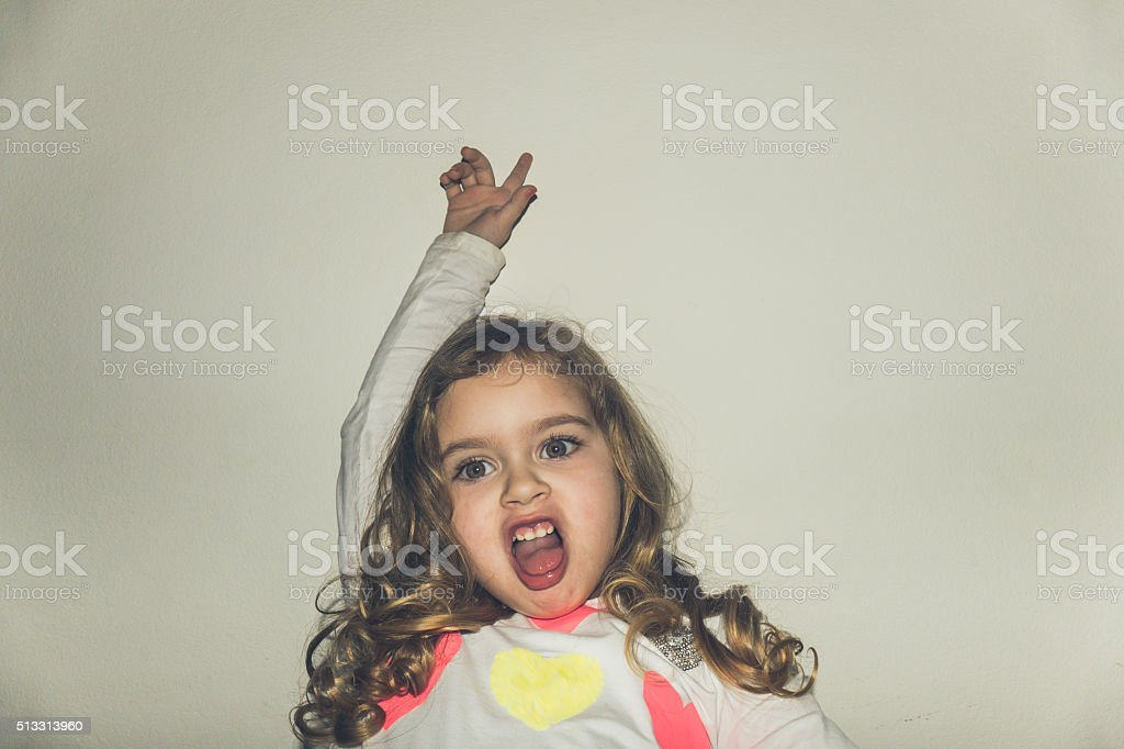 Beautiful young girl with magic eyes looking silly stock photo