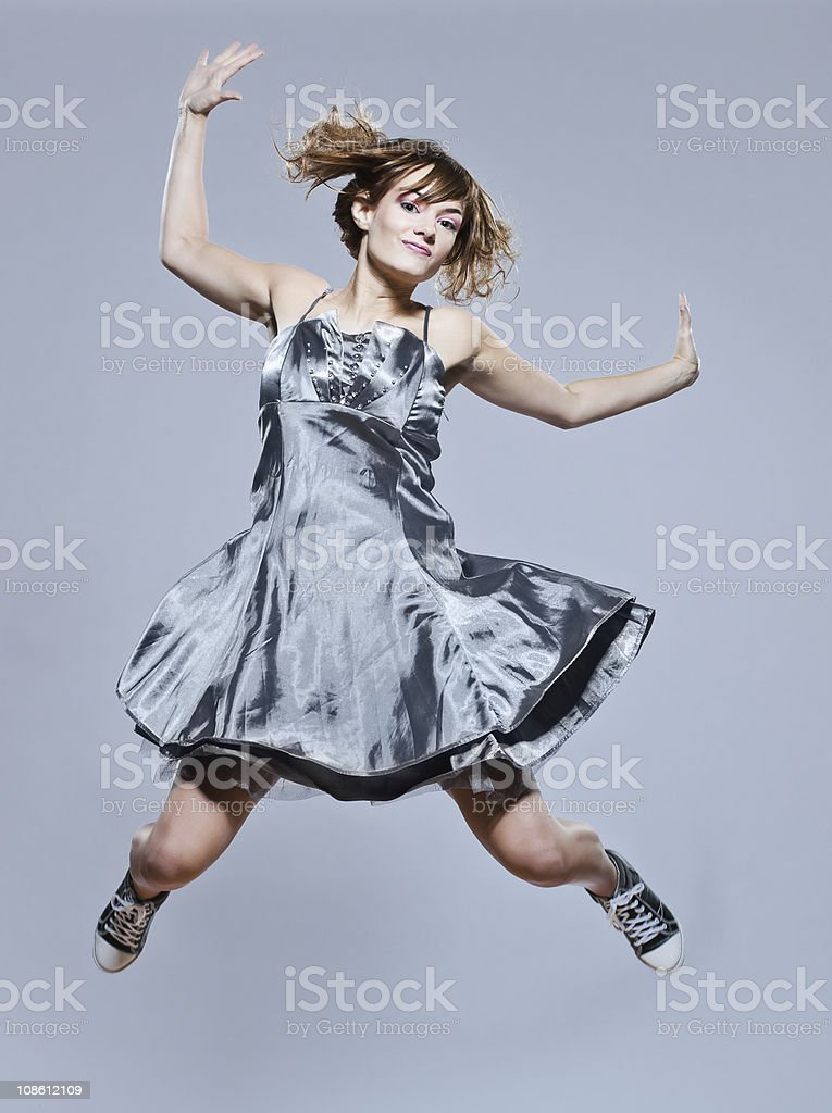 beautiful young girl with prom dress jumping happy stock photo