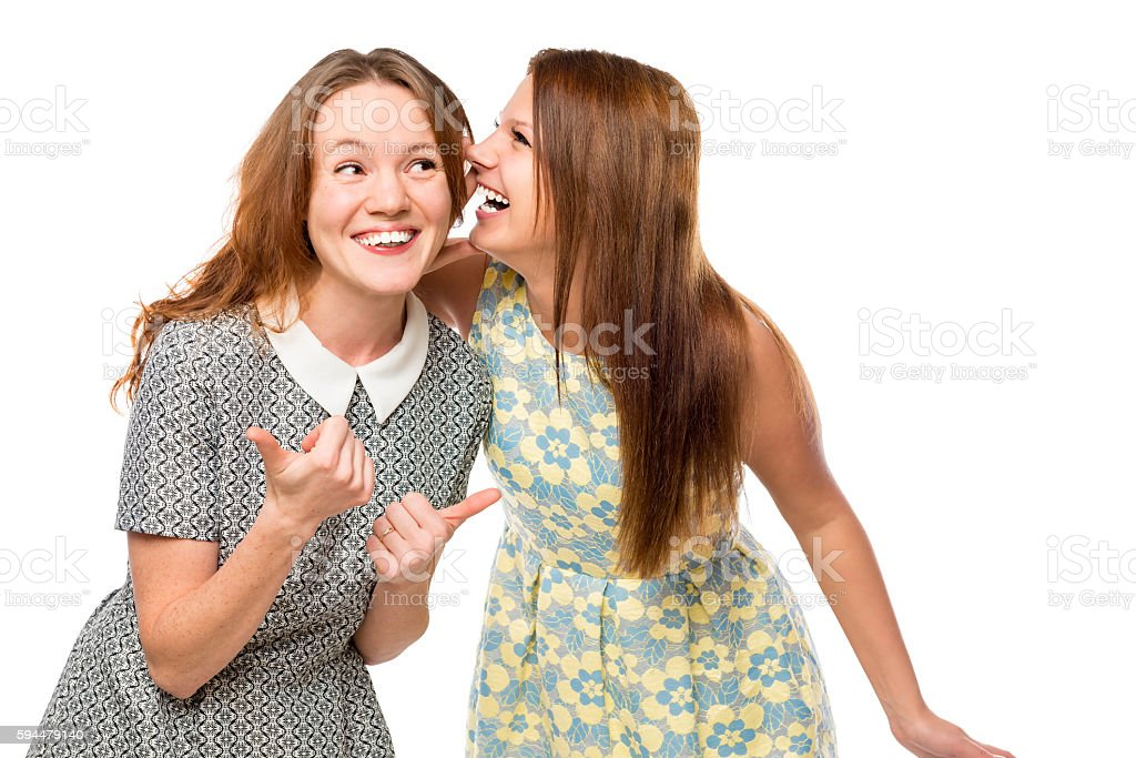 beautiful young girlfriends gossiping over white background stock photo