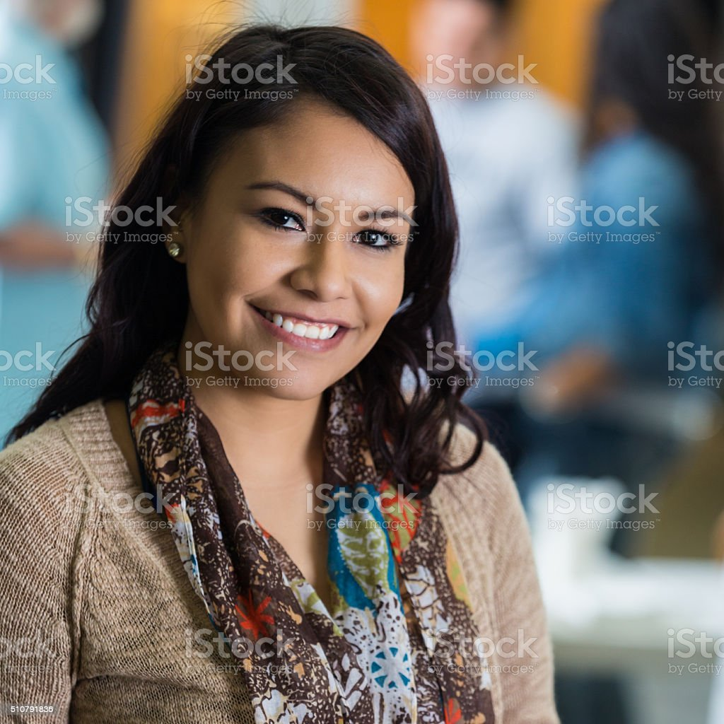 Beautiful young Hispanic woman at community food drive stock photo