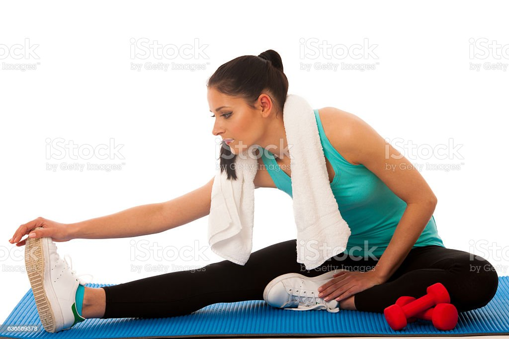 Beautiful young hispanic woman doing lunge exercise in fitness stock photo