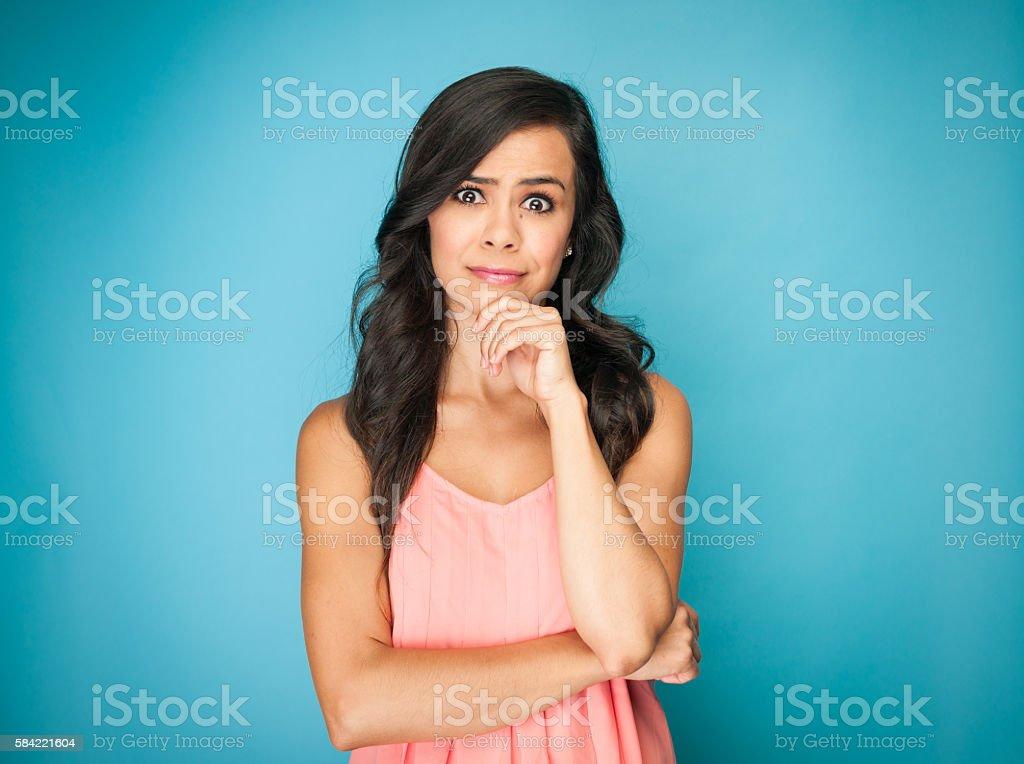 Beautiful Young Hispanic Women Questioning stock photo
