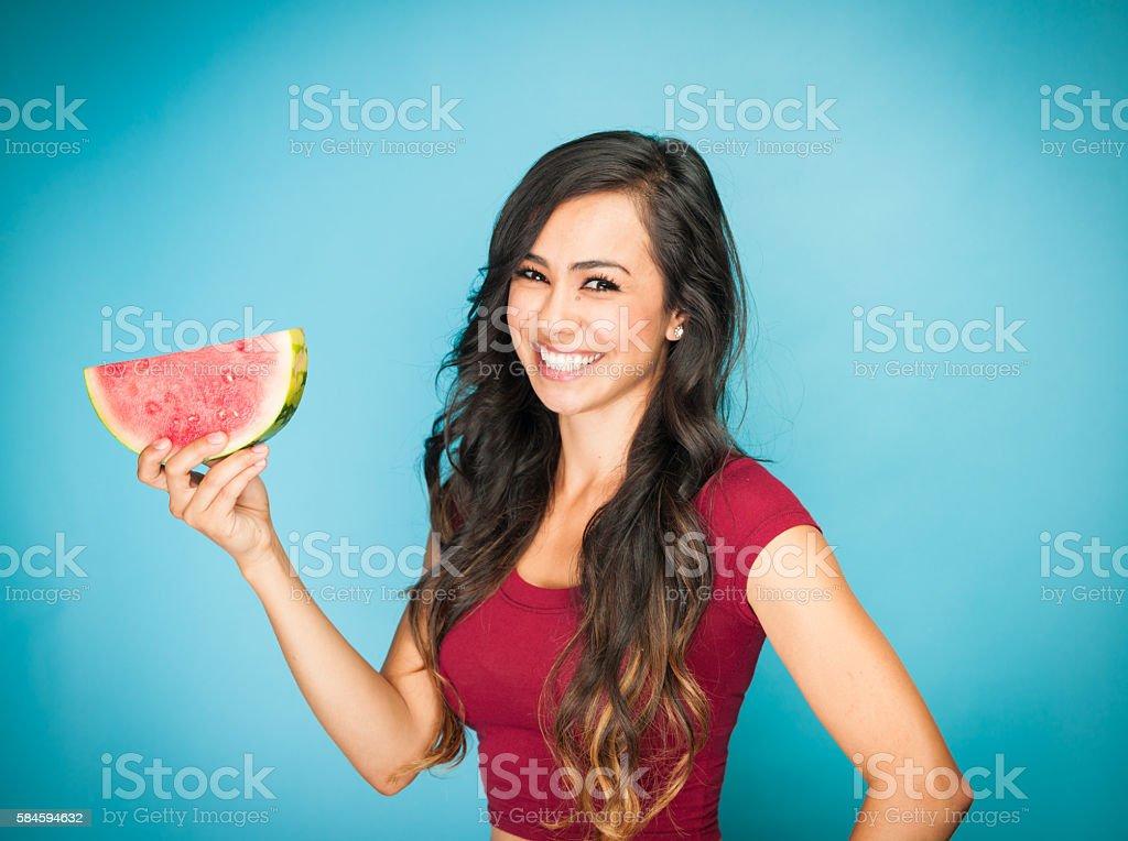 Beautiful Young Hispanic Women With Watermelon stock photo