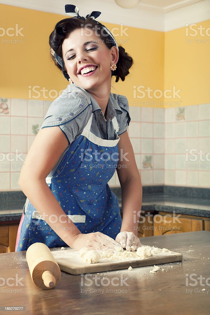 Beautiful Young Housewife In Kitchen royalty-free stock photo
