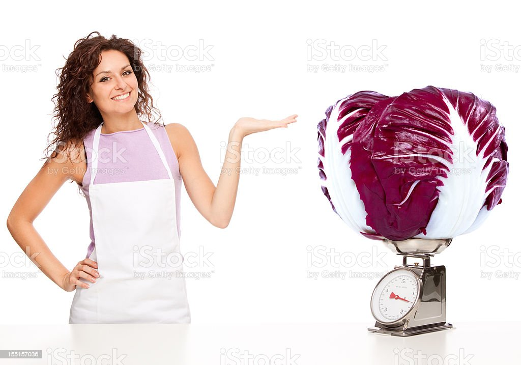 Beautiful young housewife with huge salad royalty-free stock photo
