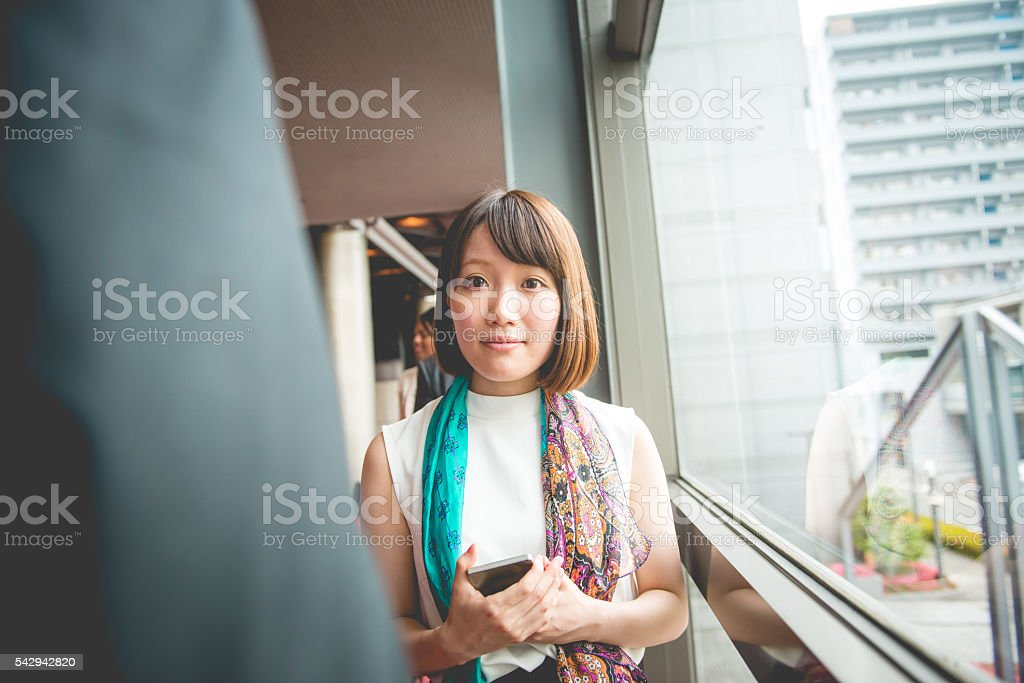 Beautiful Young Japanese Businesswoman with Smart Phone, Kyoto, Japan stock photo