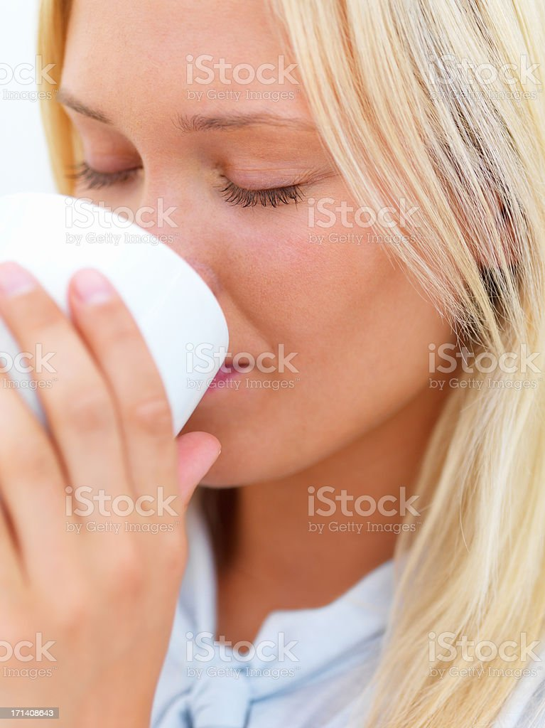 Beautiful young lady drinking coffee royalty-free stock photo