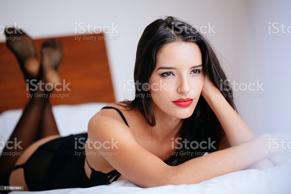 Beautiful young lady in sexy underwear on bed stock photo