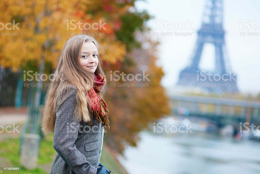 Beautiful young lady on a fall day in Paris royalty-free stock photo