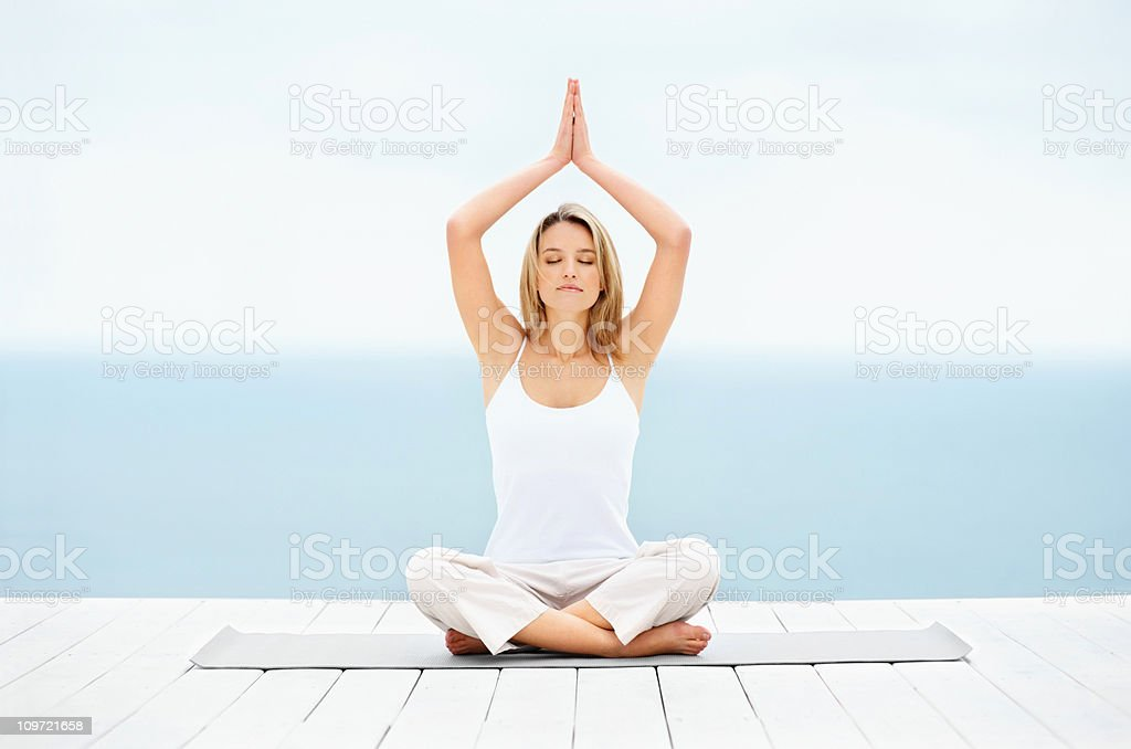 Beautiful young lady practicing yoga outdoors royalty-free stock photo