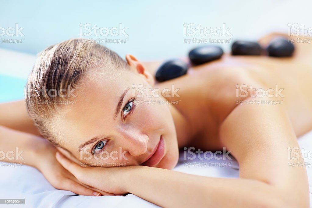 Beautiful young lady with black stones on her bare back royalty-free stock photo