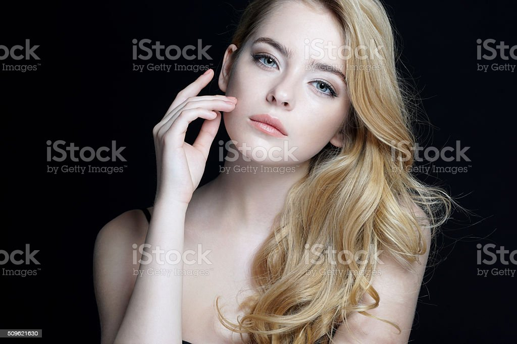 Beautiful young lady with make up face. stock photo
