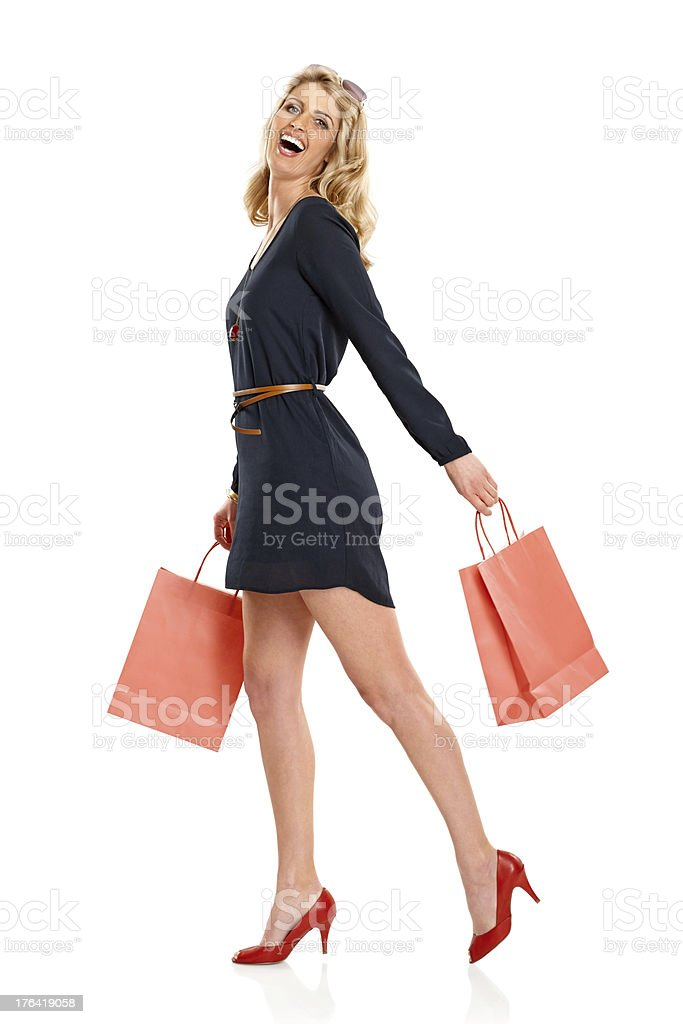 Beautiful young lady with shopping bags royalty-free stock photo