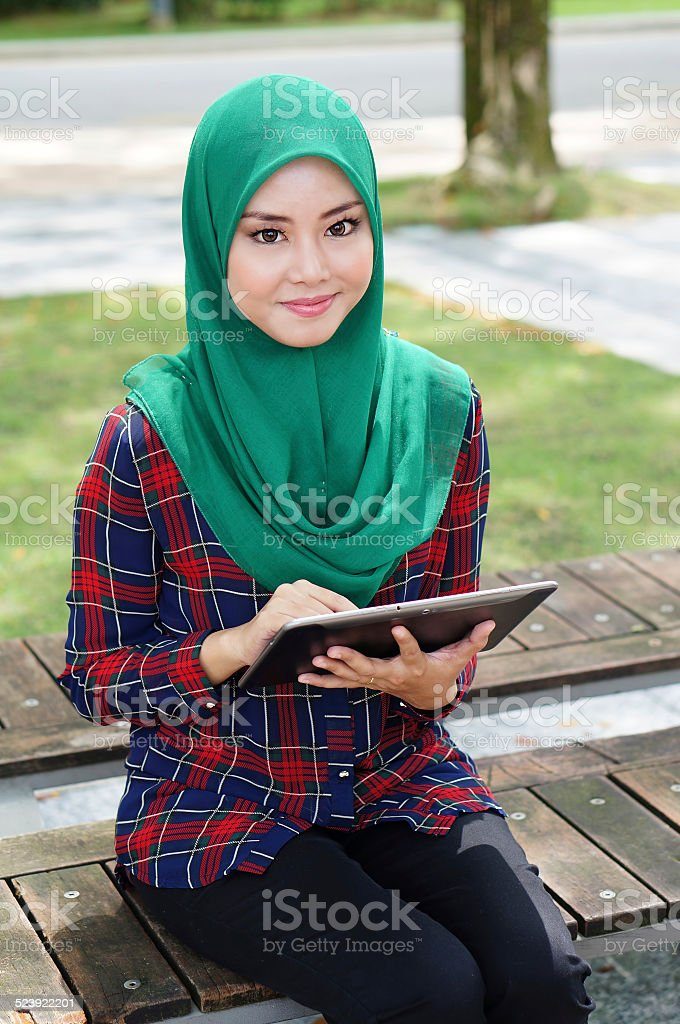 Beautiful young lady with tablet computer stock photo