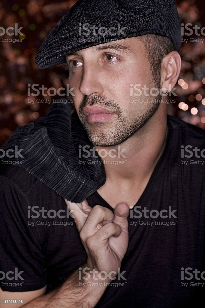 Beautiful Young Man Fashion Model in Hat, Jacket Over Shoulder stock photo