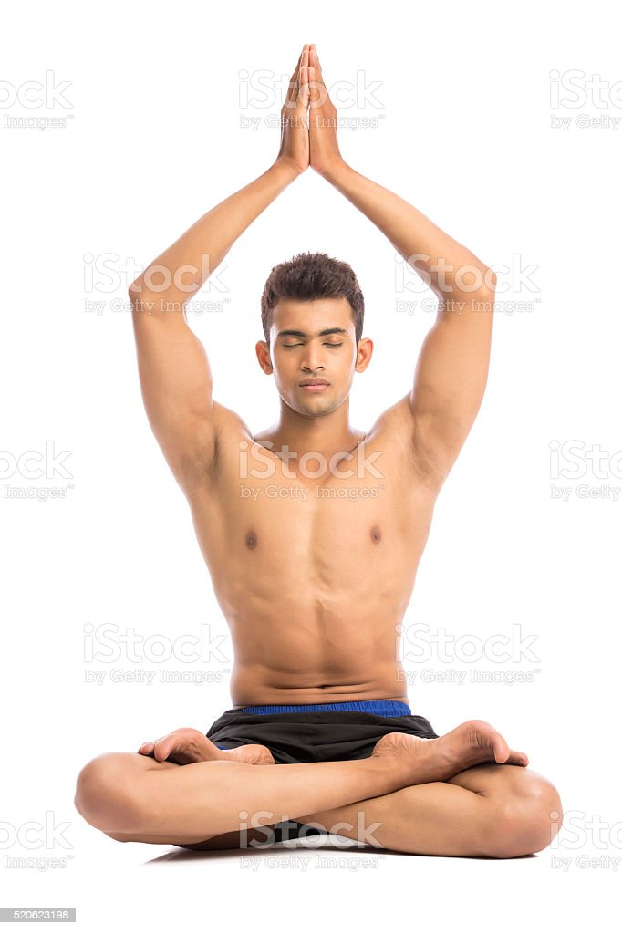 beautiful young man meditating with yoga pose stock photo