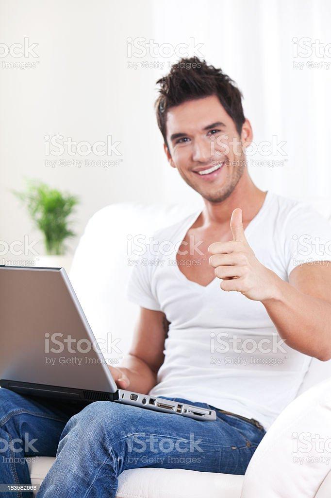 Beautiful young man using laptop computer royalty-free stock photo