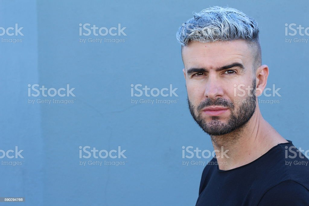 Beautiful young man with dyed white hair stock photo