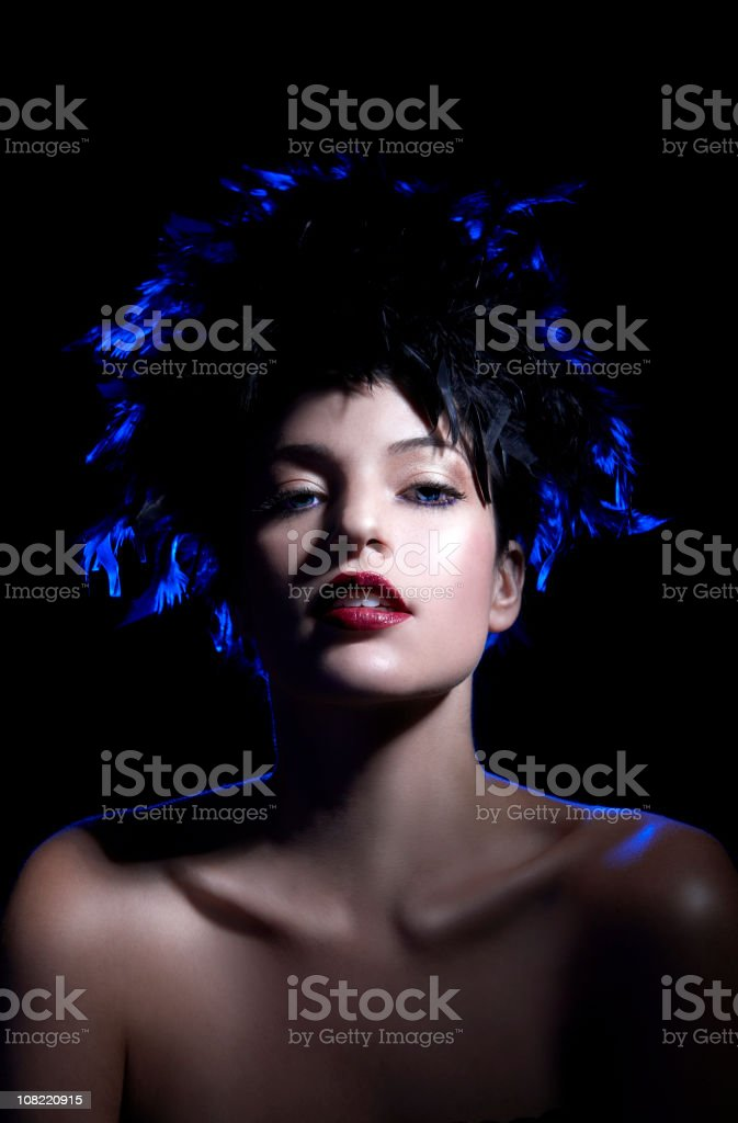 Beauty Shot of Caucasian Model in Feather Hat on Black royalty-free stock photo