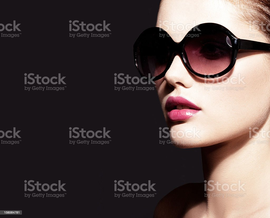 Beautiful young model with big sunglasses stock photo