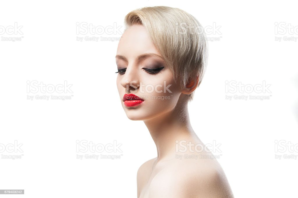 Beautiful young model with blonde short hair and red lips stock photo