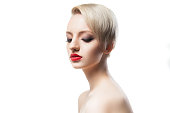 Beautiful young model with blonde short hair and red lips