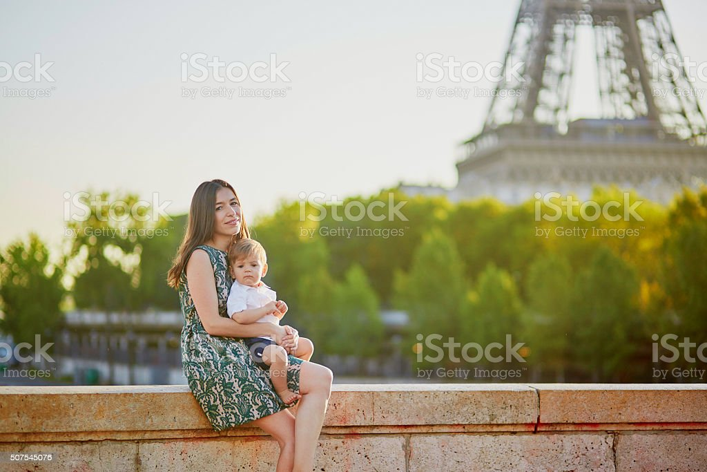 Beautiful young mother with her adorable in Paris, France stock photo