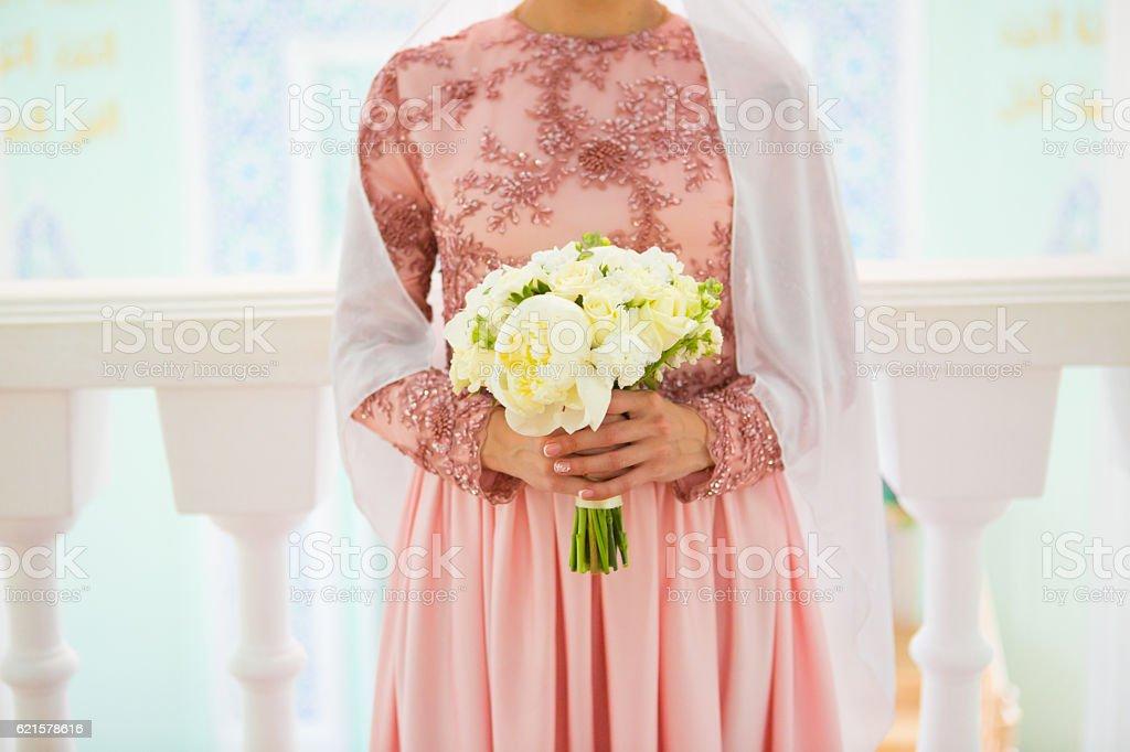Beautiful young muslim bride preparing for wedding stock photo