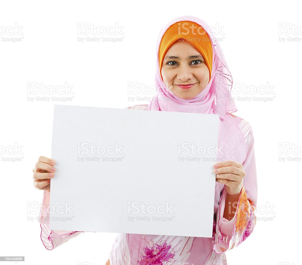 Beautiful Young Muslim girl holding a white card board stock photo