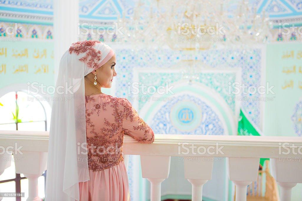 Beautiful young oriental bride preparing for wedding stock photo