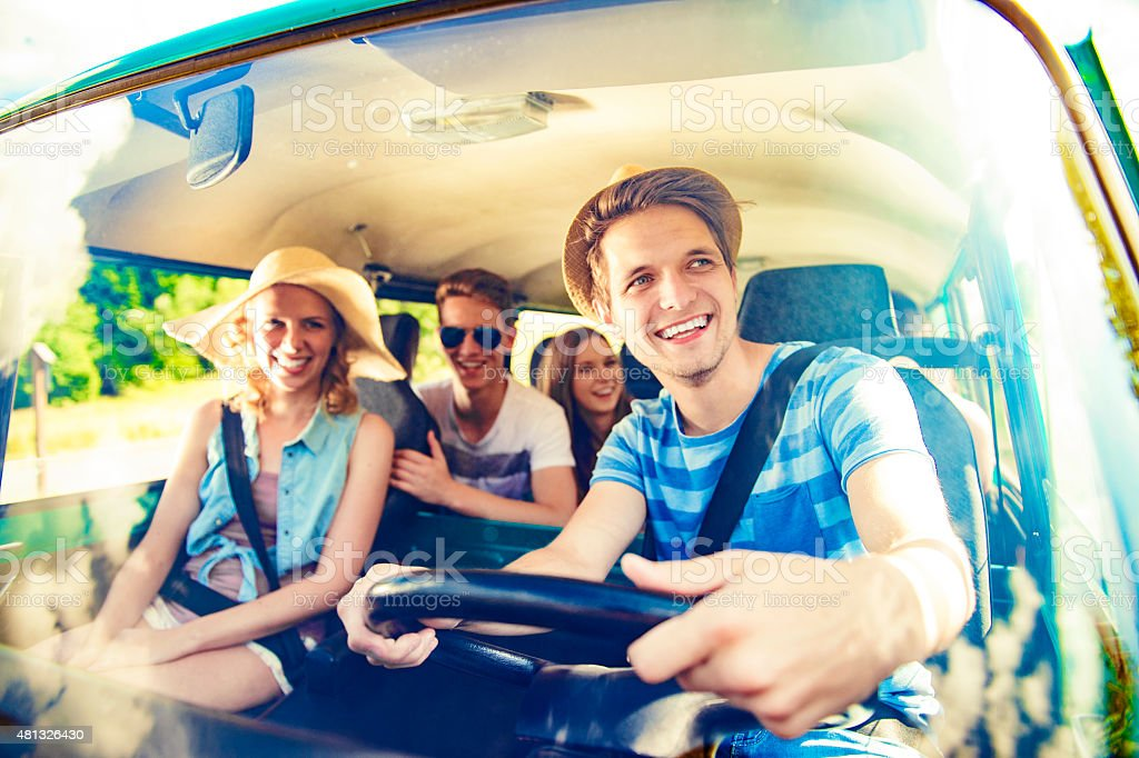 Beautiful young people on a road trip stock photo