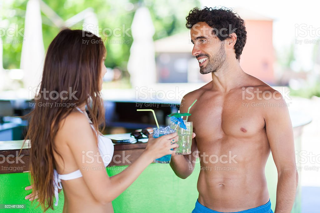 Beautiful young people talking in a cafe on the beach stock photo