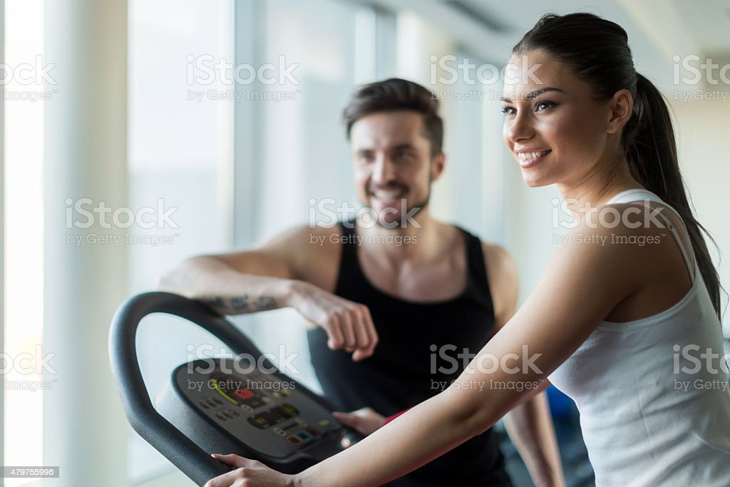 Beautiful, young people talking in a gym while working out stock photo