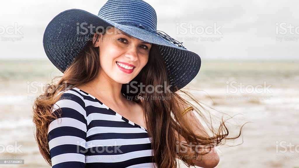 Beautiful young pregnant woman on the beach stock photo
