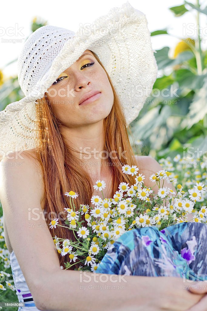 Beautiful young red-haired woman with bouquet of fresh daisies outdoors royalty-free stock photo
