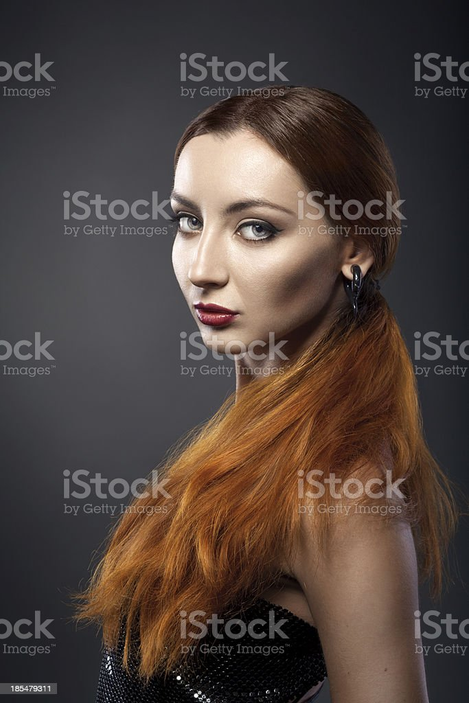 beautiful young redhead woman isolated on dark background royalty-free stock photo