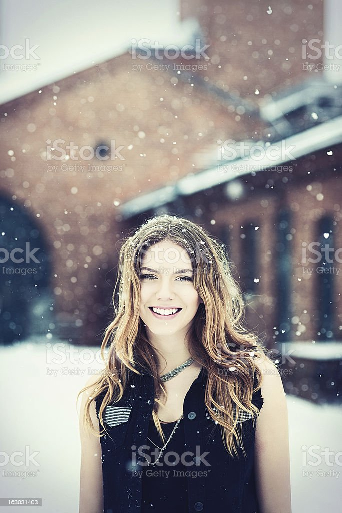 Beautiful young rock chic woman out in snow royalty-free stock photo