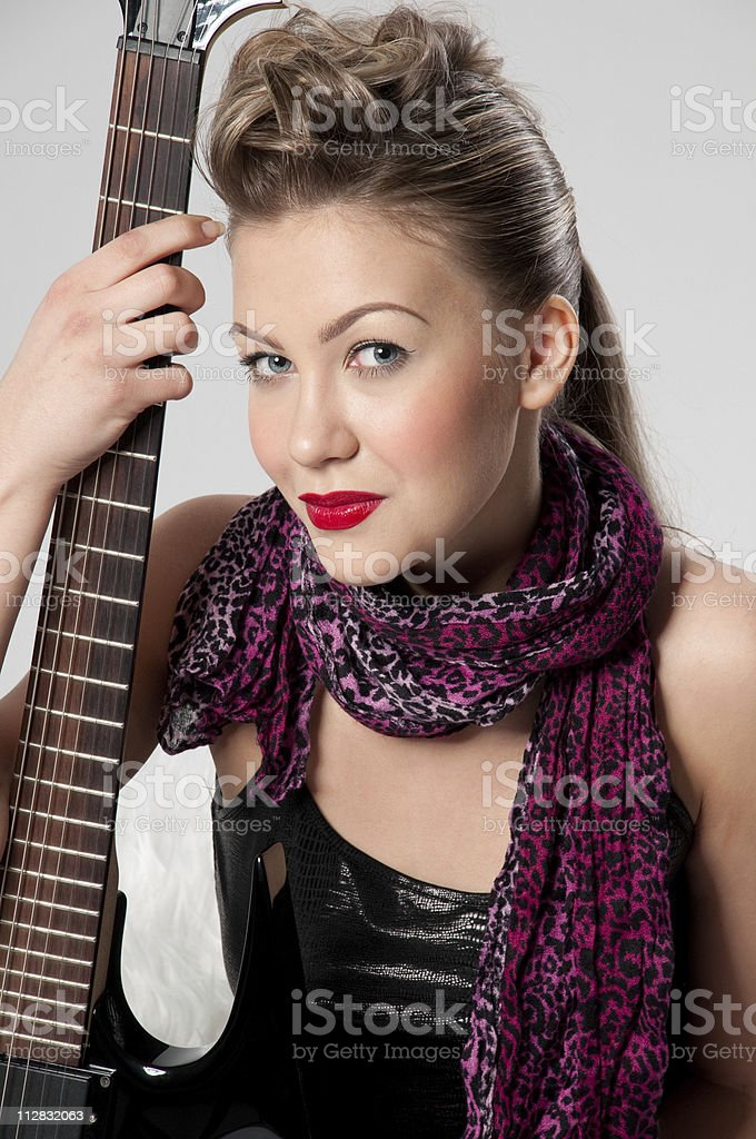 Beautiful young rock girl with black guitar royalty-free stock photo
