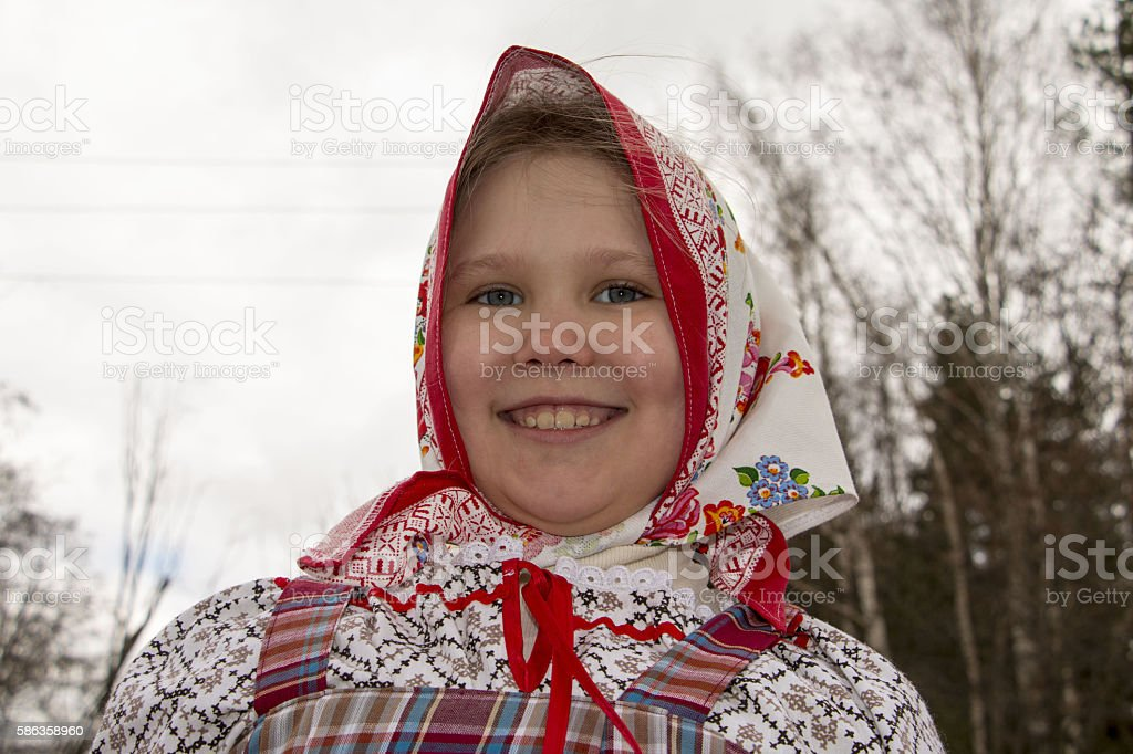 Beautiful young Russian girl in national dress stock photo