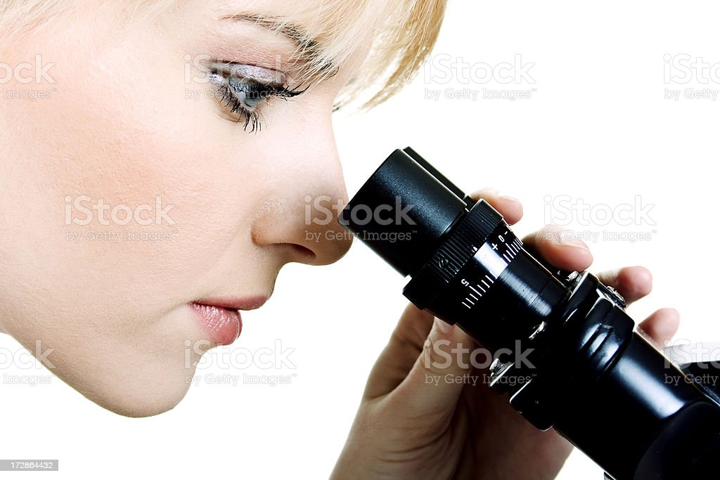 Beautiful young scientist with microscope royalty-free stock photo