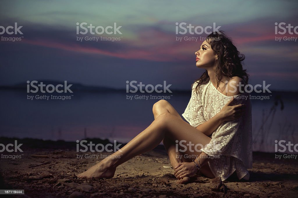 Beautiful young sexy fashion model by the sea royalty-free stock photo