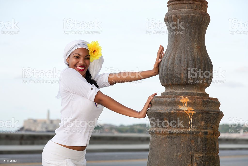 Beautiful, young standing next to street lamp, Havana, Cuba stock photo