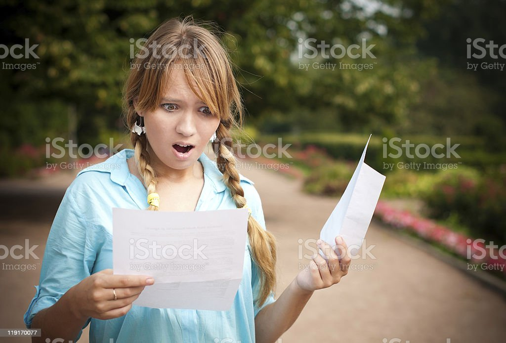 beautiful young student girl with letter stock photo