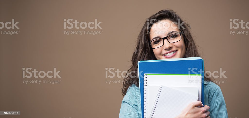 Beautiful young student posing stock photo