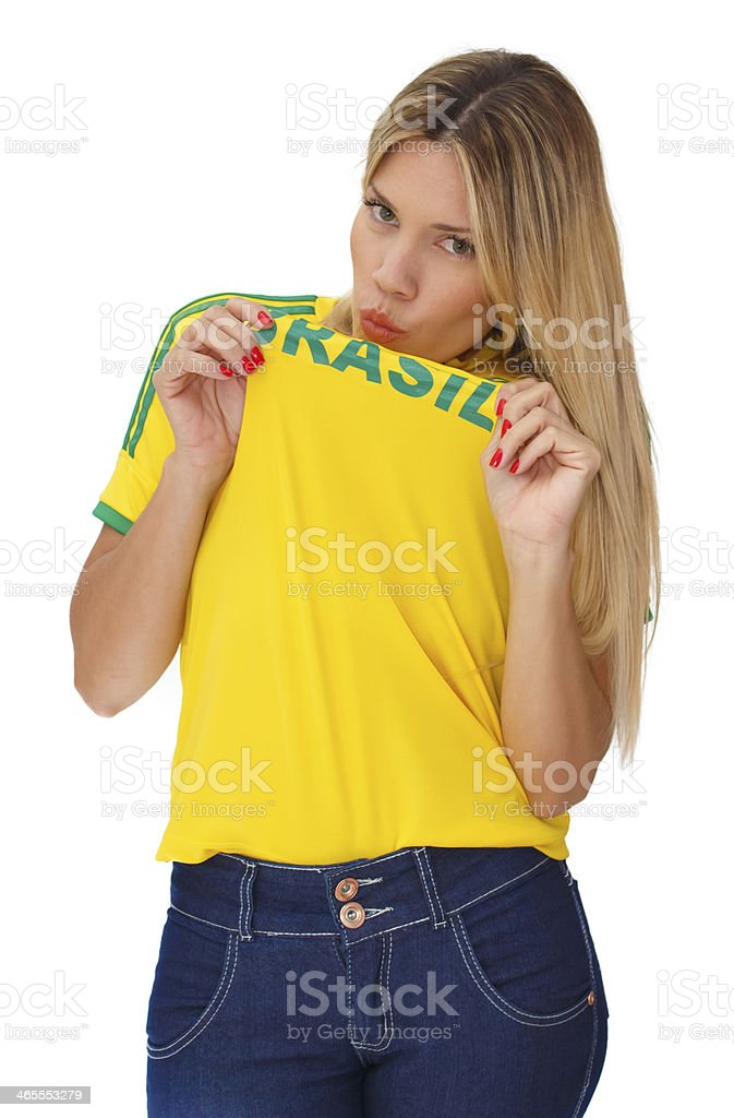 Beautiful young supporter of Brazil kissing the shirt stock photo