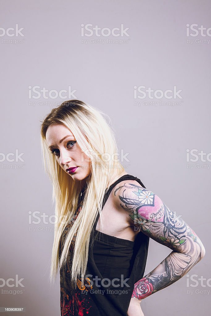 Beautiful Young Tattooed Woman royalty-free stock photo