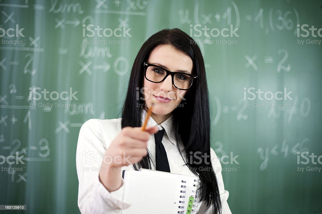 Beautiful young teacher pointing at camera royalty-free stock photo