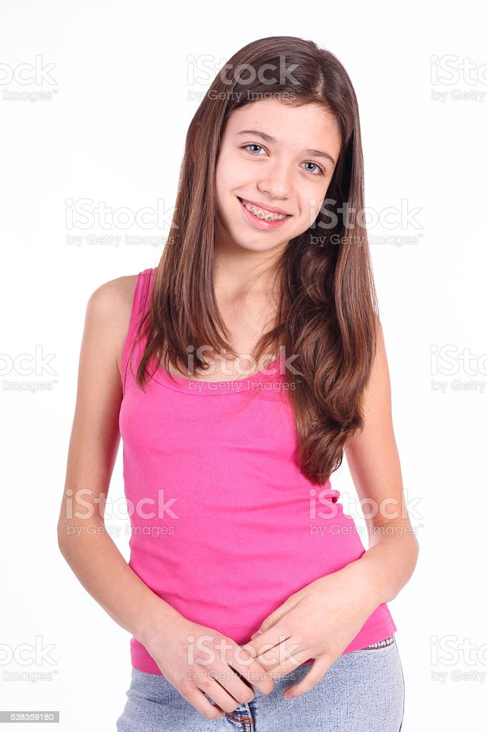 Beautiful young teen girl with brackets on teeth in white stock photo