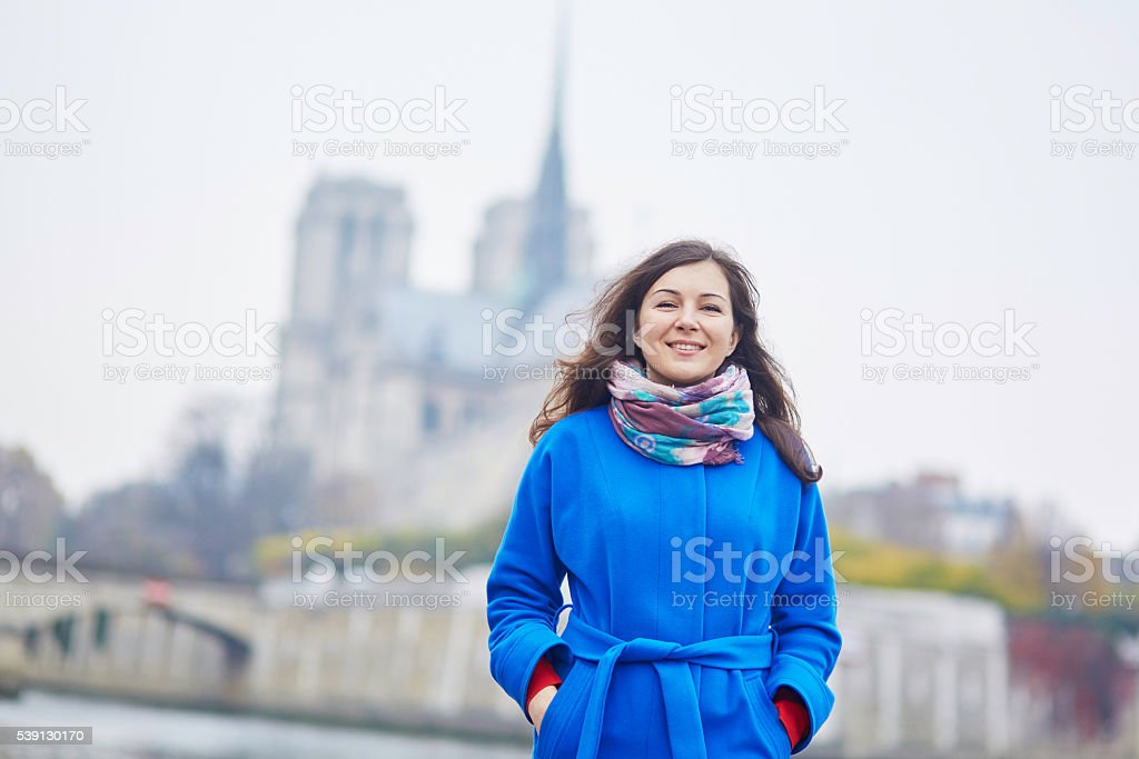 Beautiful young tourist in Paris on a fall day stock photo