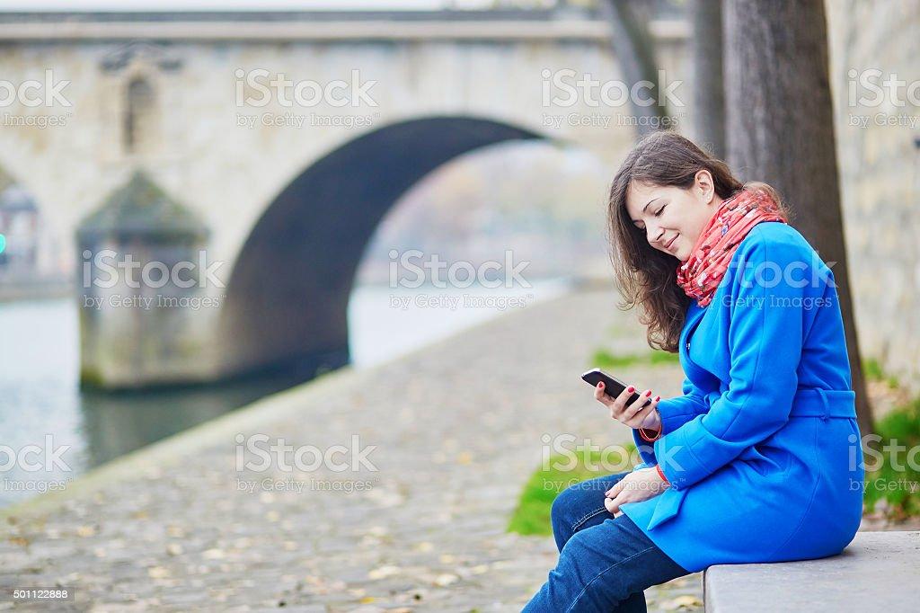 Beautiful young tourist in Paris stock photo